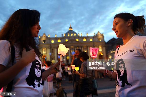 Two women hold candles as people gather in St Peter's Square to mark the 30th anniversary of the disappearance of Emanuela Orlandi on June 22 2013 in...
