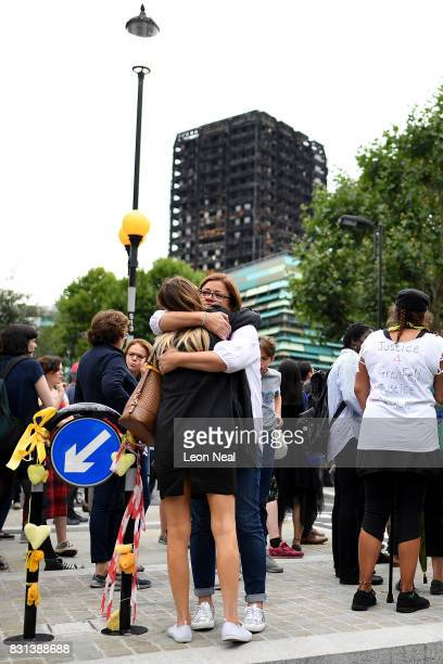 Two women hug during a silent march to mark the two month anniversary of the Grenfell Tower Fire on August 14 2017 in London England 80 people have...