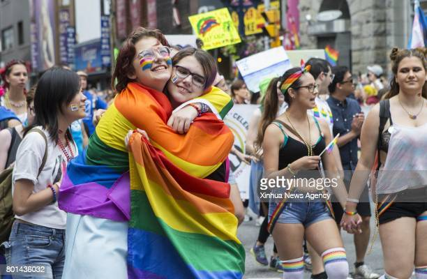 Two women hug during the 2017 Pride Parade in Toronto Canada June 25 2017