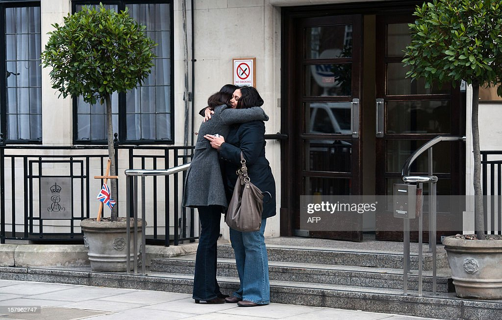 Two women hug on the steps of the King Edward VII hospital in central London on December 8, 2012 after exiting the hospital together the day after Jacintha Saldanha, a nurse at the hospital, was found dead at a property close by. Two Australian radio presenters who made a hoax call to the hospital treating Prince William's pregnant wife Catherine were taken off the air on December 8 after Saldanha the nurse who took the call was found dead, in circumstances that police have described unexplained.