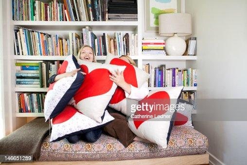 Two Women Hugging Heat Shaped Pillows
