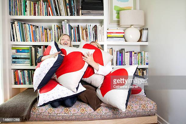 Two Women Hugging Heat Shaped Pillows