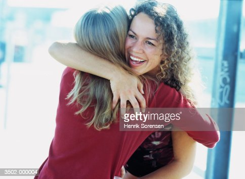 Two Women Hugging : Stock Photo