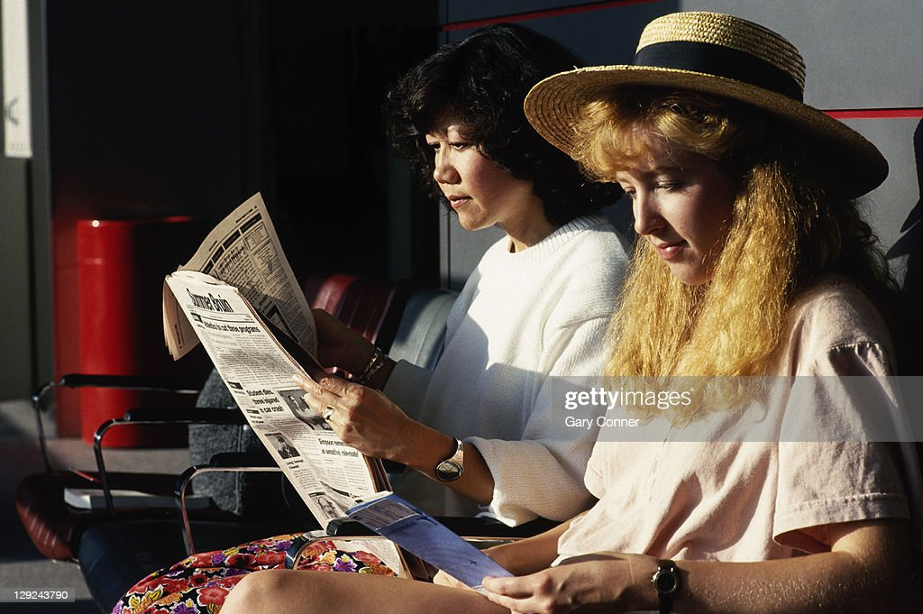 Two women in airport terminal : Stock Photo