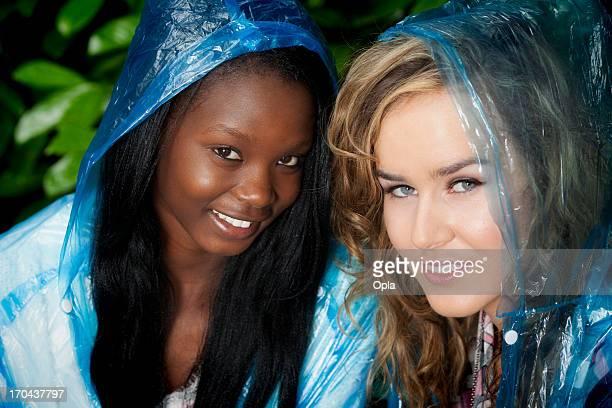 Two women in blue plastic rain poncho's