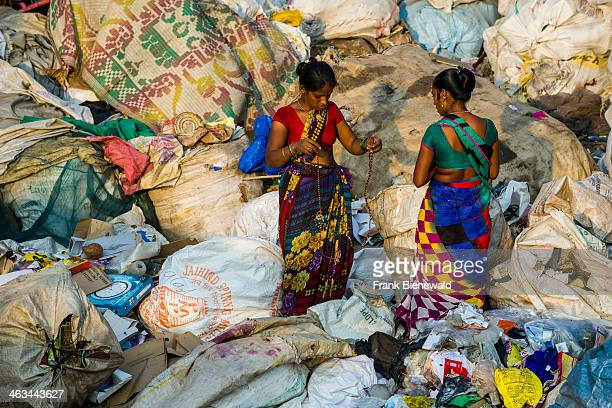 Two women in colorful saris are sorting out garbage About 10000 labourers are working in 800 little companies mainly in the garbage recycling...