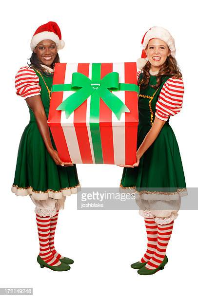 Two women in costume holding a Christmas present