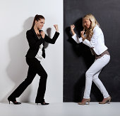 Two women in fighting pose