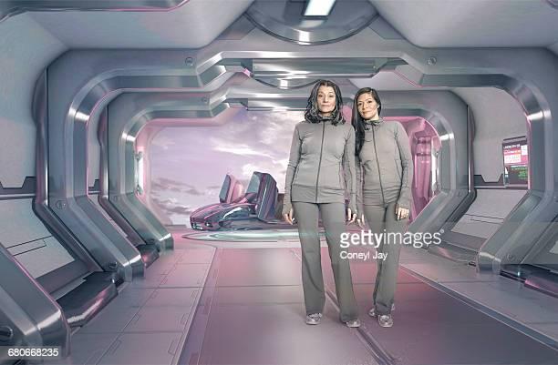 Two women in futuristic apartment