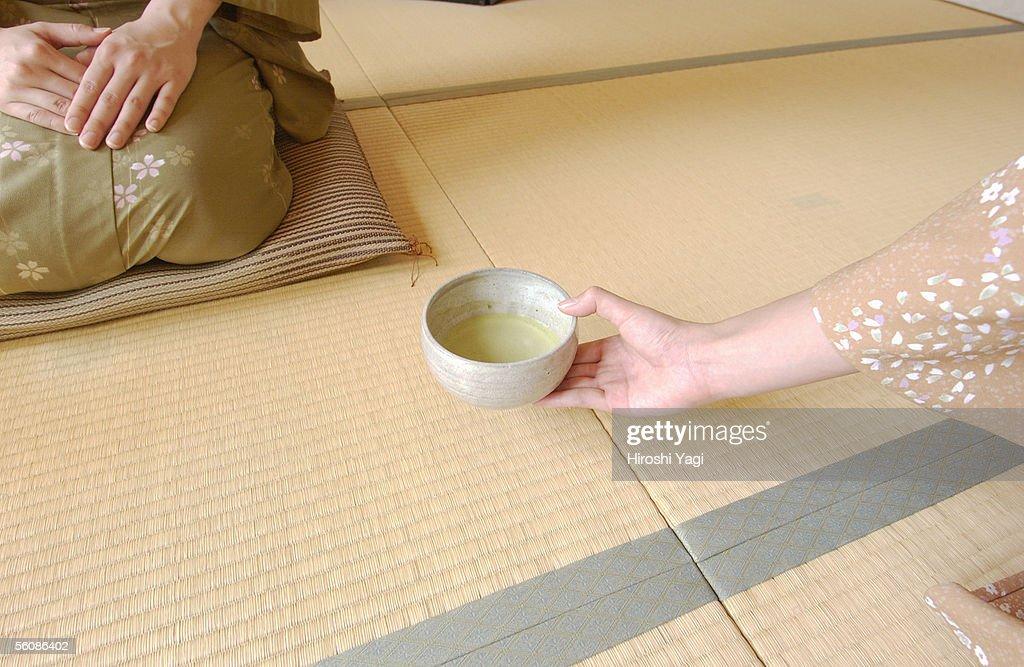 Two women in kimono attending tea ceremony : Stock Photo