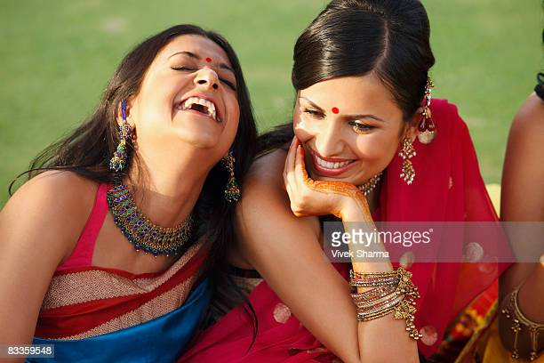 two women in saris, laughing