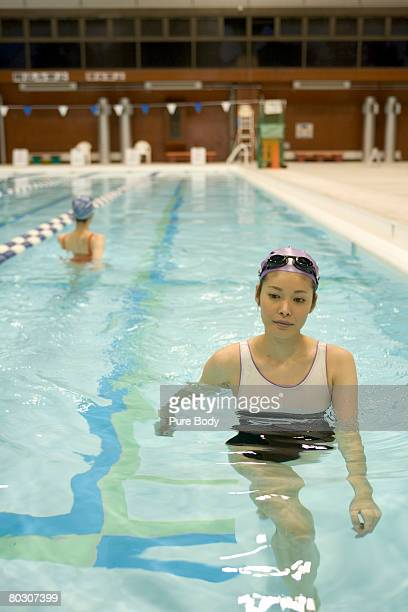 Woman Leaving Swimming Pool Stock Photos And Pictures Getty Images