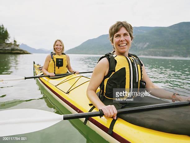 Two women kayaking, portrait