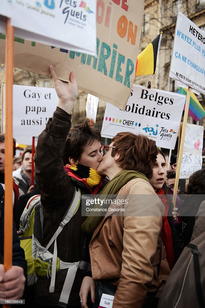 Two women kiss during a marriage for all demonstration on January 28, 2013 in Paris, France. The marriage equality bill, which will be debated at the French National Parliament, would not only legalize same-sex marriage and also allow gay couples to adopt, a controversial issue in the bill. French President Francois Hollande supports the legislation but faces criticism from anti-gay and religious groups, while gay rights groups have concerns of inadequacies within the bill.
