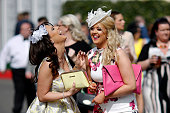 Two women laugh during Ladies Day on day two of the three day Grand National meeting at Aintree racecourse on April 10 2015 in Liverpool England