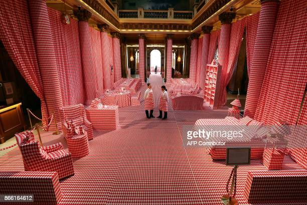 Two women look around at the entrance of the Casino of MonteCarlo decorated for the 'Let's fall in diamonds' exhibition by Belgian artist and...