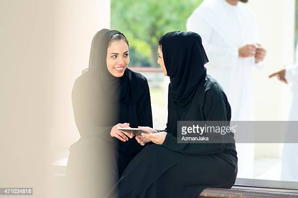 Two women looking at a booklet
