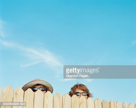 Two women looking over fence