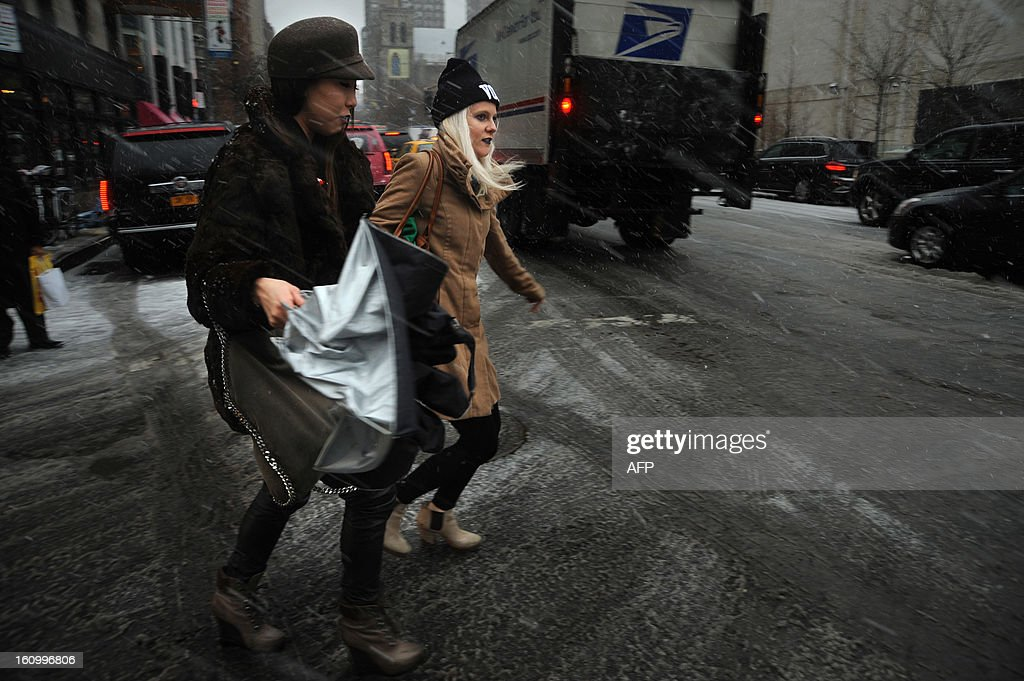Two women make their way through the snow in New York on February 8, 2013 during a storm affecting the northeast US. The storm was forecast to bring the heaviest snow to the densely-populated northeast corridor so far this winter, threatening power and transport links for tens of millions of people and the major cities of Boston and New York. New York and other regional airports saw more than 4,500 cancellations ahead of what the National Weather Service called 'a major winter storm with blizzard conditions' along most of the region's coastline.