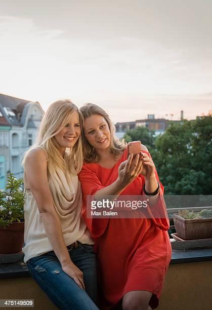 Two women making self portrait, Berlin, Germany