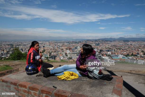 Two women motorcyclists take a break while enjoying the sunshine on the spot known as 'Mirador de la Paloma' on La Calera road or better known as...