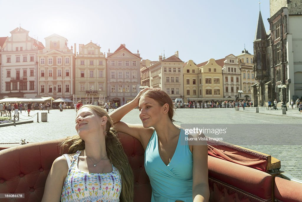 Two women on a horse carriage