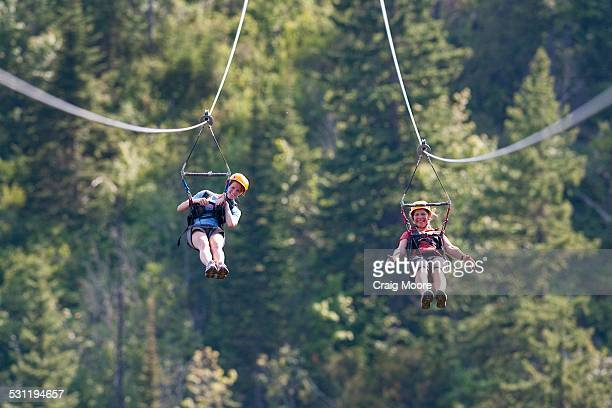 Two women on a zip line in Whitefish, Montana.