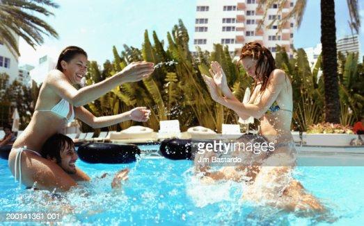Girls wreatling in pool