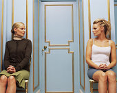Two women on opposite sides of a doorway