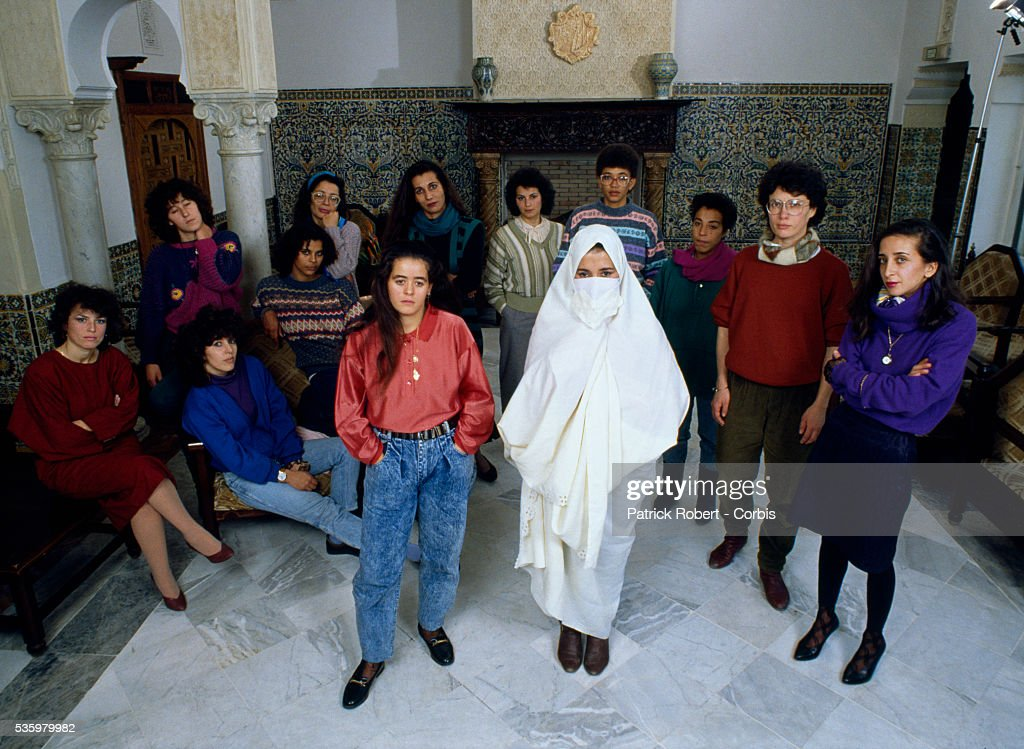 Two women, one wearing jeans and modern clothing, the other veiled in a traditional manner, illustrate the varied backgrounds of women participating in an association for equal legal rights for men and women in Algiers. Women in Algeria have struggled against a society and legal system that does not grant them rights equal to those of men.