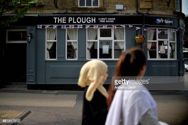 Two women pass The Plough public house in Rotherham ahead of a visit from Labour Party leader Jeremy Corbyn later today on May 10 2017 in Rotherham...