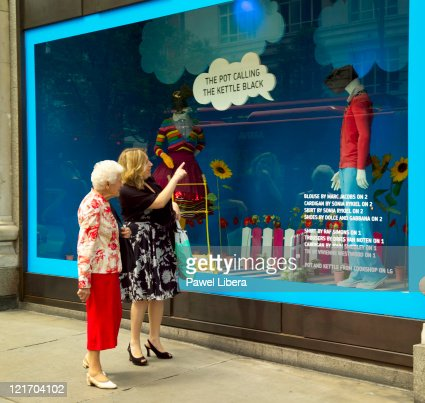 Two Women Passing by Selfridges Department Store, Oxfrod Street, London, UK
