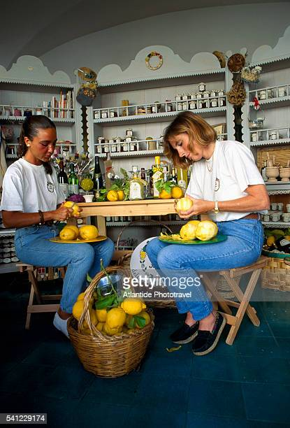 Two Women Peeling Lemons