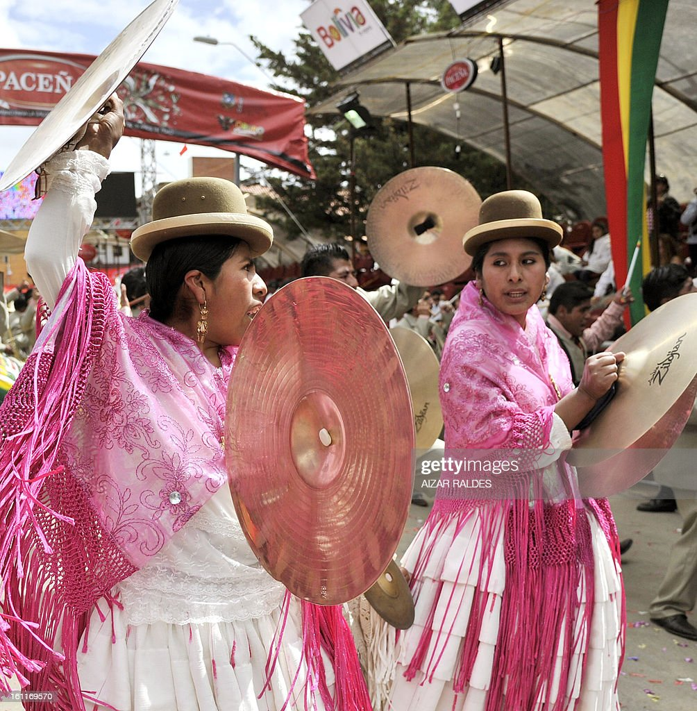 Two women performs during the Carnival of Oruro, in the mining town of Oruro, 240 km south of La Paz on February 9, 2013. The Carnival of Oruro was inscribed by UNESCO on the Representative List of the Intangible Cultural Heritage of Humanity in 2008.