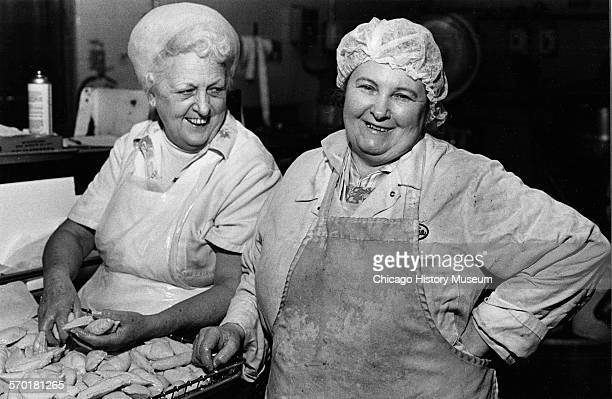 Two women pierogi makers in aprons and hairnets at Pola Foods located at 2303 West Cermak Road Chicago Illinois 1988