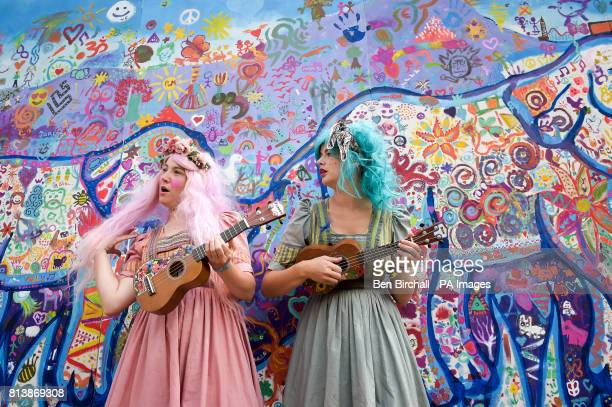 Two women play ukulele at Glastonbury Festival Worthy Farm Somerset PRESS ASSOCIATION Photo Picture date Sunday June 2017 Photo credit should read...