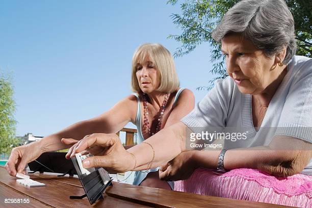 Two women playing mahjong