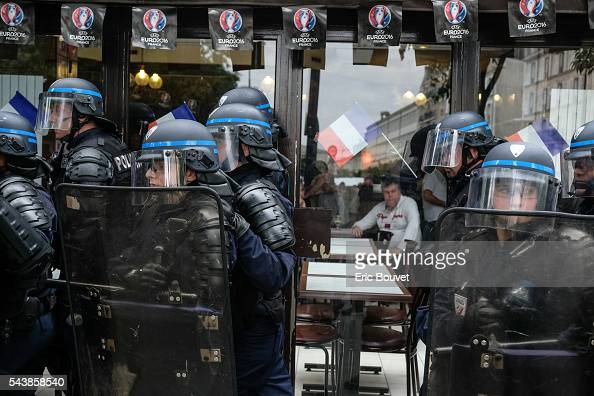 Two women police forces attend the Demonstration Against The 'El Khomri' Law Project In Paris on June 28 2016 in Paris France