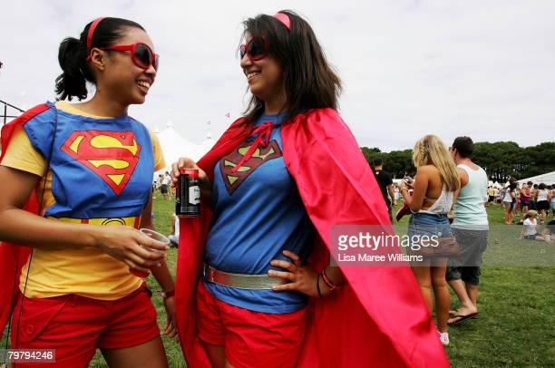 Two women pose in fancy dress costume during the Good Vibrations Festival in Centennial Park on February 16 2008 in Sydney Australia