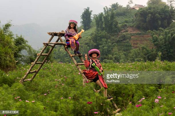 Two women pose with typical costume in Cat Cat village in the village of San Sa Ho Sa Pa district Lao Cai province is a beautiful destination on a...