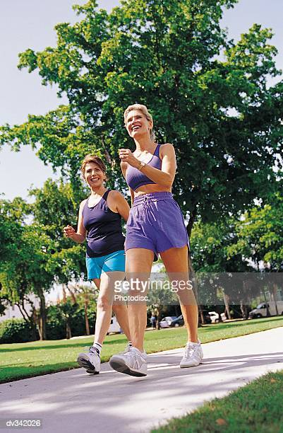 Two women power walking