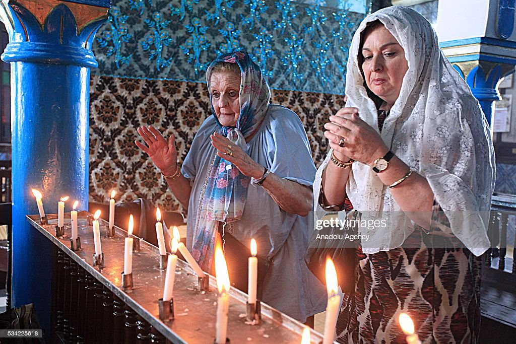 Two women pray next to candles as Jews from different countries visit Synagogue La ghriba to celebrate Lag BaOmer in Djerba, Tunisia on May 25, 2016.