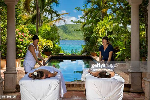 two women receiving massages at a beautiful villa in Caribbean