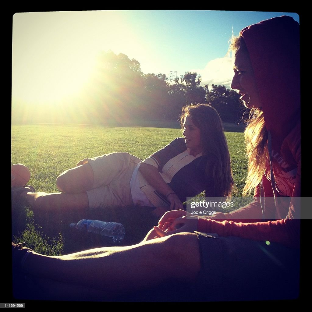 Two women relaxing in afternoon sun