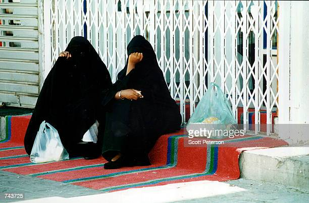 Two women rest with their shopping bags in Dhahran Saudi Arabia July 1996