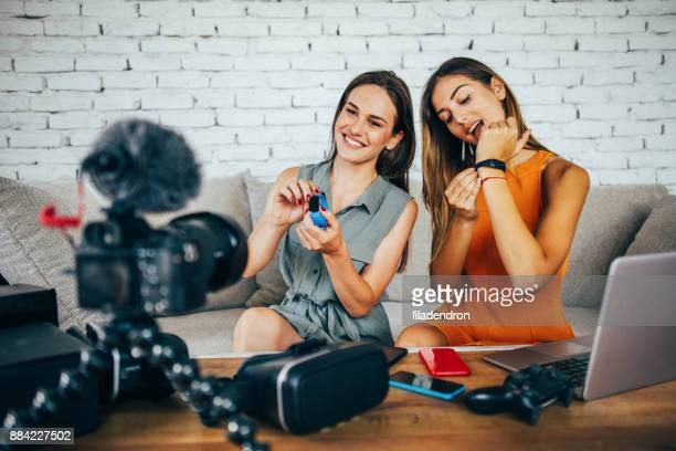 Two women reviewing smart watches