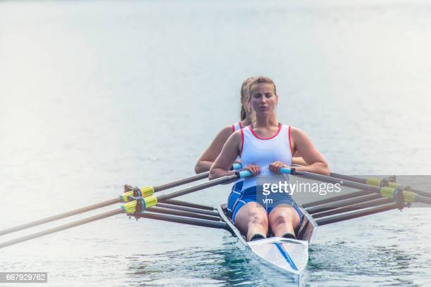 Two women rowing on a lake