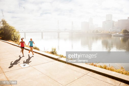 Two women running for exercise. : Bildbanksbilder