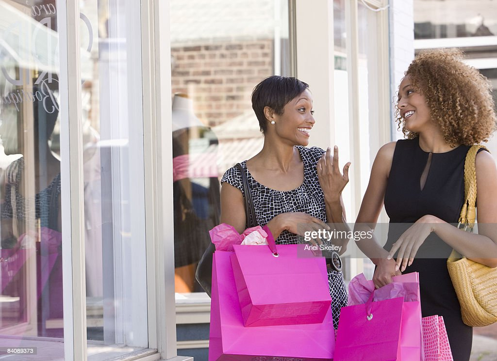 Two Women Shopping in Downtown of City : Stock Photo