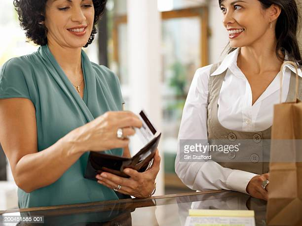 Two women shopping together in boutique